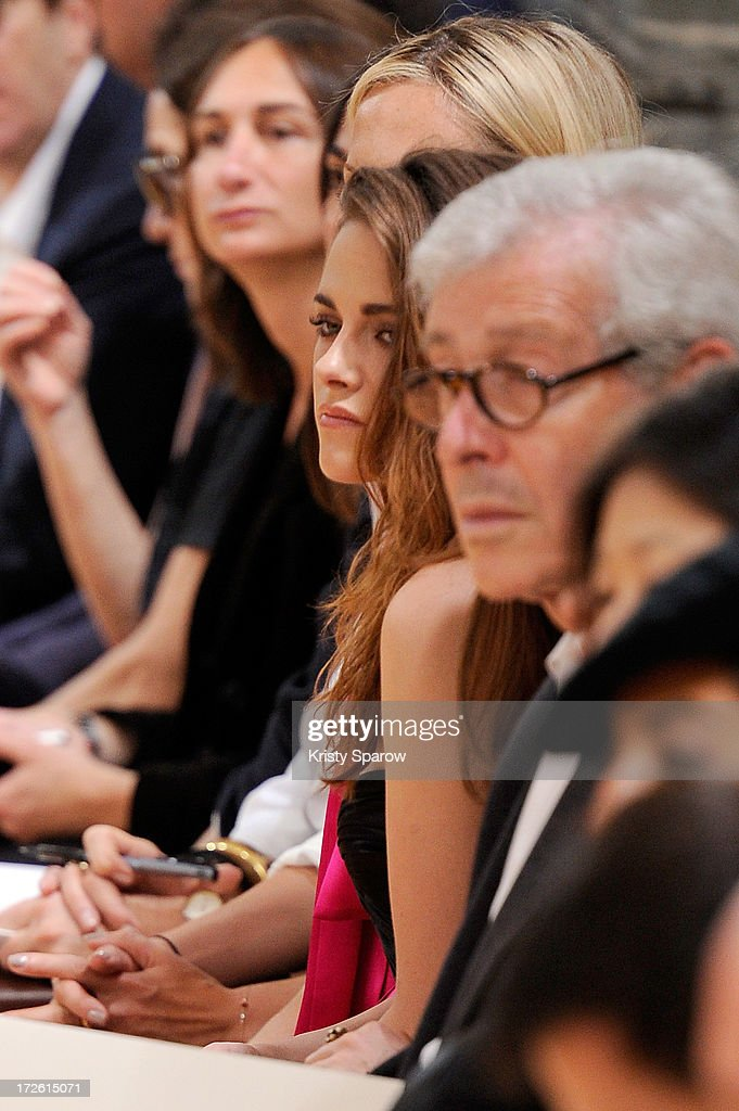 Kristen Stewart watches the Zuhair Murad show from the front row as part of Paris Fashion Week Haute-Couture Fall/Winter 2013-2014 at Hotel de Montmorency on July 4, 2013 in Paris, France.