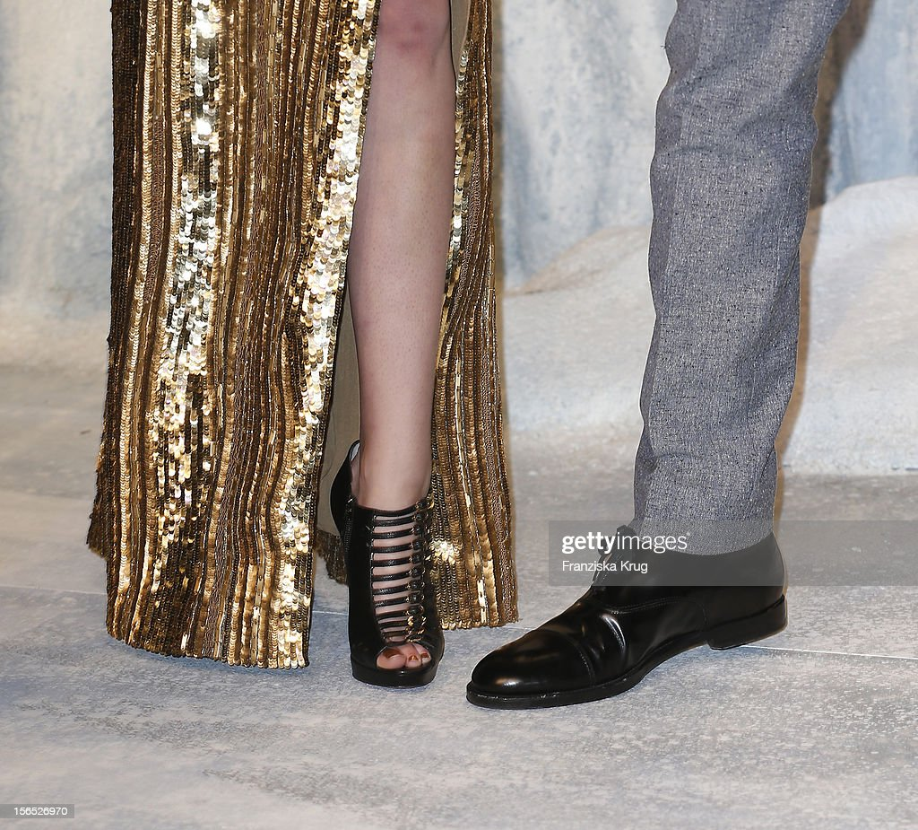 Kristen Stewart's high-heels and Robert Pattinson's shoes on the red carpet at the 'Twilight Saga: Breaking Dawn Part 2' Germany Premiere at CineStar on November 16, 2012 in Berlin, Germany.