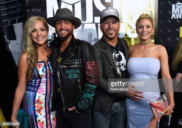 Kristen White Preston Brust and Chris Lucas of LoCash and Kaitlyn Lucas attend the 2017 CMT Music Awards at the Music City Center on June 7 2017 in...
