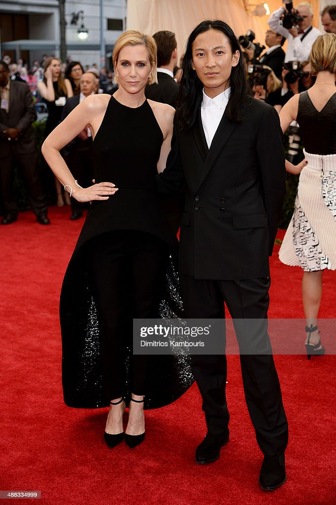 Kristen Wiig (L) and Alexander Wang attend the 'Charles James: Beyond Fashion' Costume Institute Gala at the Metropolitan Museum of Art on May 5, 2014 in New York City.