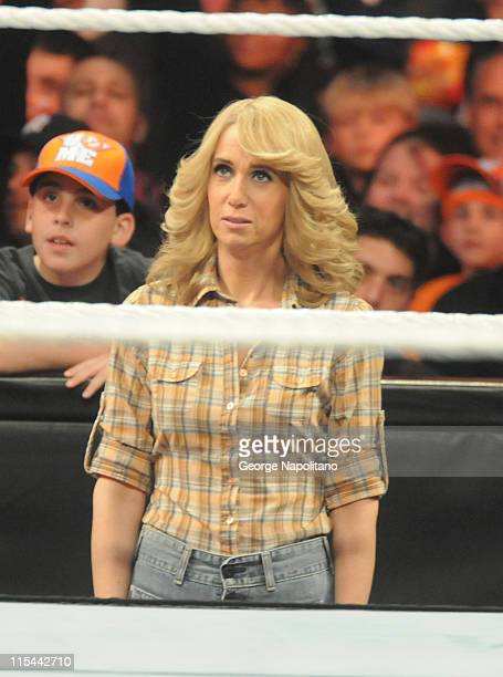 Kristen Wiig stands outside the ring at the WWE Monday Night Raw at the Izod Center on April 19 2010 in East Rutherford New Jersey