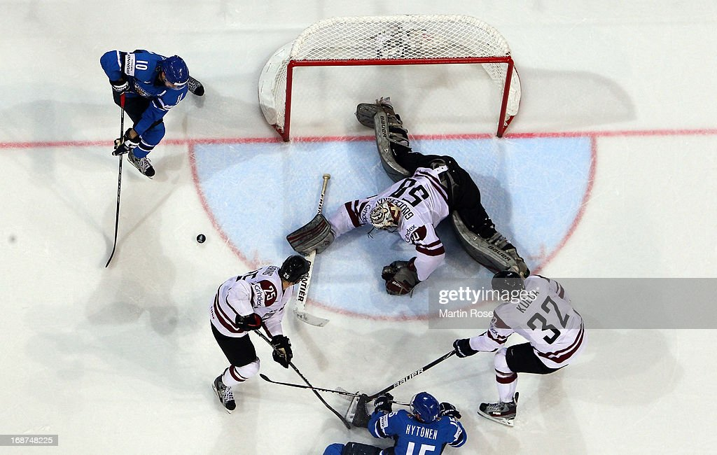 Kristers Gudlevskis (#50), goaltender of Latvia makes a save on <a gi-track='captionPersonalityLinkClicked' href=/galleries/search?phrase=Niklas+Hagman&family=editorial&specificpeople=203179 ng-click='$event.stopPropagation()'>Niklas Hagman</a> (#10) of Finland during the IIHF World Championship group H match between Latvia and Finland at Hartwall Areena on May 14, 2013 in Helsinki, Finland.