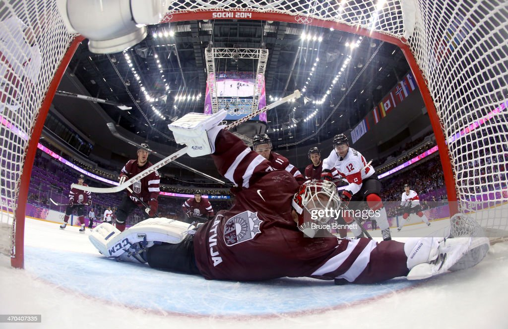 Kristers Gudlevskis #50 of Latvia makes a save during the third period of the Men's Ice Hockey Quarterfinal Playoff on Day 12 of the 2014 Sochi Winter Olympics at Bolshoy Ice Dome on February 19, 2014 in Sochi, Russia.