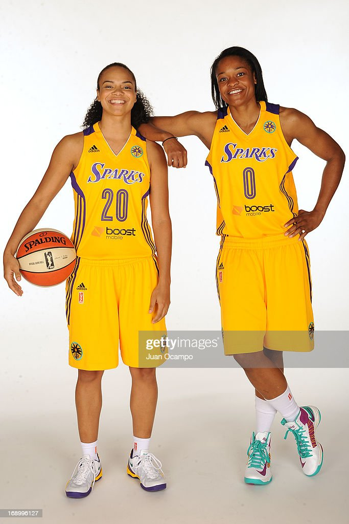 Kristi Toliver #20 and Alana Beard #0 of the Los Angeles Sparks pose for a photo during the Los Angeles Sparks Media Day on May 17, 2013 at St. Mary's School in Inglewood, California.
