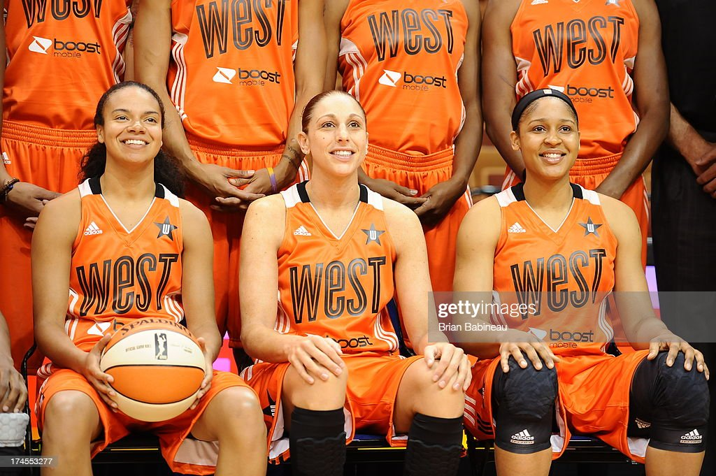 Kristi Toliver #20, Diana Taurasi #3, and Maya Moore #23 of the Western Conference All-Stars pose for a photo before the 2013 Boost Mobile WNBA All-Star Game on July 27, 2013 at Mohegan Sun Arena in Uncasville, Connecticut.