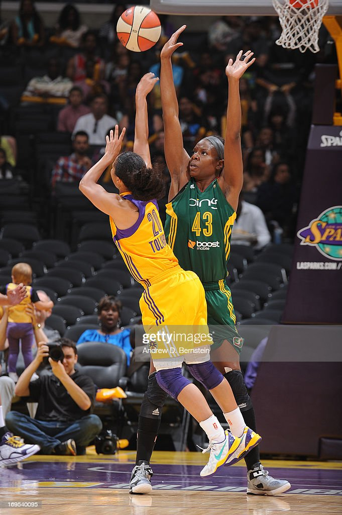 Kristi Toliver of the Los Angeles Sparks attempts a shot against Nakia Sanford of the Seattle Storm during a game at Staples Center on May 26 2013 in...