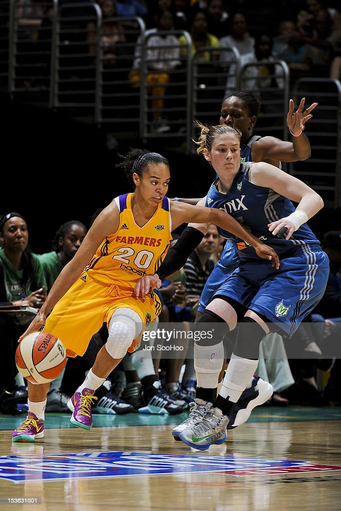 Kristi Toliver #20 of the Los Angeles Sparks drives against <a gi-track='captionPersonalityLinkClicked' href=/galleries/search?phrase=Lindsay+Whalen&family=editorial&specificpeople=208984 ng-click='$event.stopPropagation()'>Lindsay Whalen</a> #13 of the Minnesota Lynx during Game Two of the WNBA Western Conference Finals at Staples Center on October 7, 2012 in Los Angeles, California.