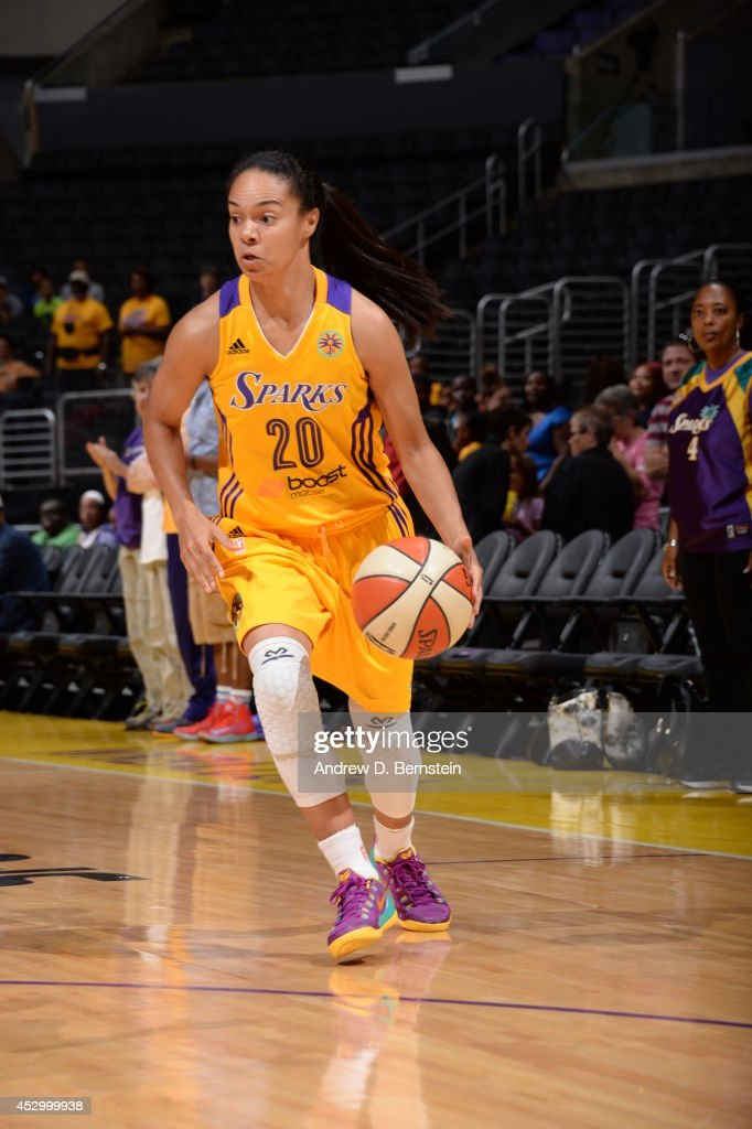 Kristi Toliver #20 of the Los Angeles Sparks drives against the Washington Mystics at STAPLES Center on July 17, 2014 in Los Angeles, California.