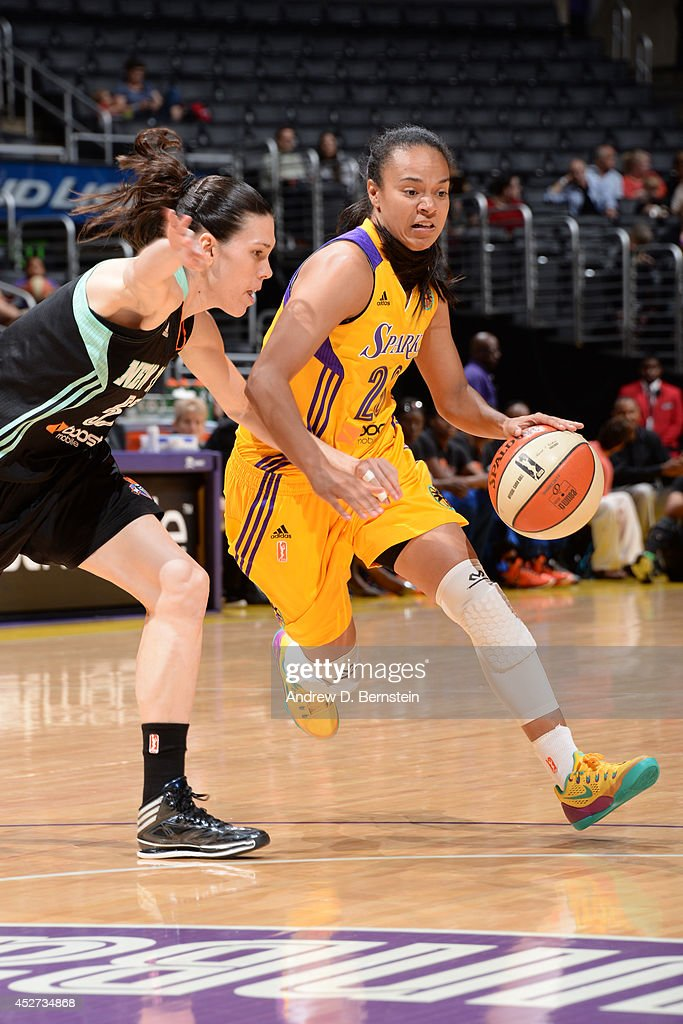 Kristi Toliver #20 of the Los Angeles Sparks drives to the basket against the New York Liberty at STAPLES Center on July 23, 2014 in Los Angeles, California.