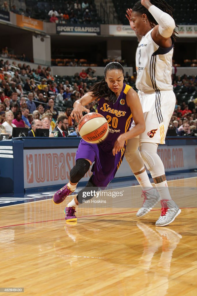 Kristi Toliver #20 of the Los Angeles Sparks drives to the basket against the Indiana Fever on July 15, 2014 at Bankers Life Fieldhouse in Indianapolis, Indiana.