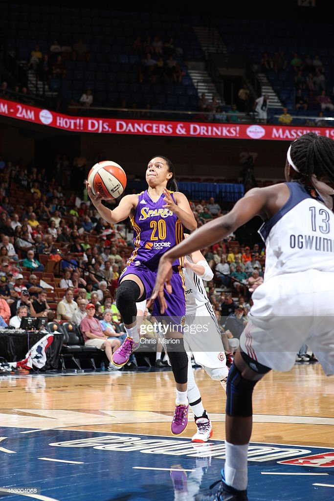 Kristi Toliver #20 of the Los Angeles Sparks drives to the basket against the Connecticut Sun during a game at the Mohegan Sun Arena on July 13, 2014 in Uncasville, Connecticut.
