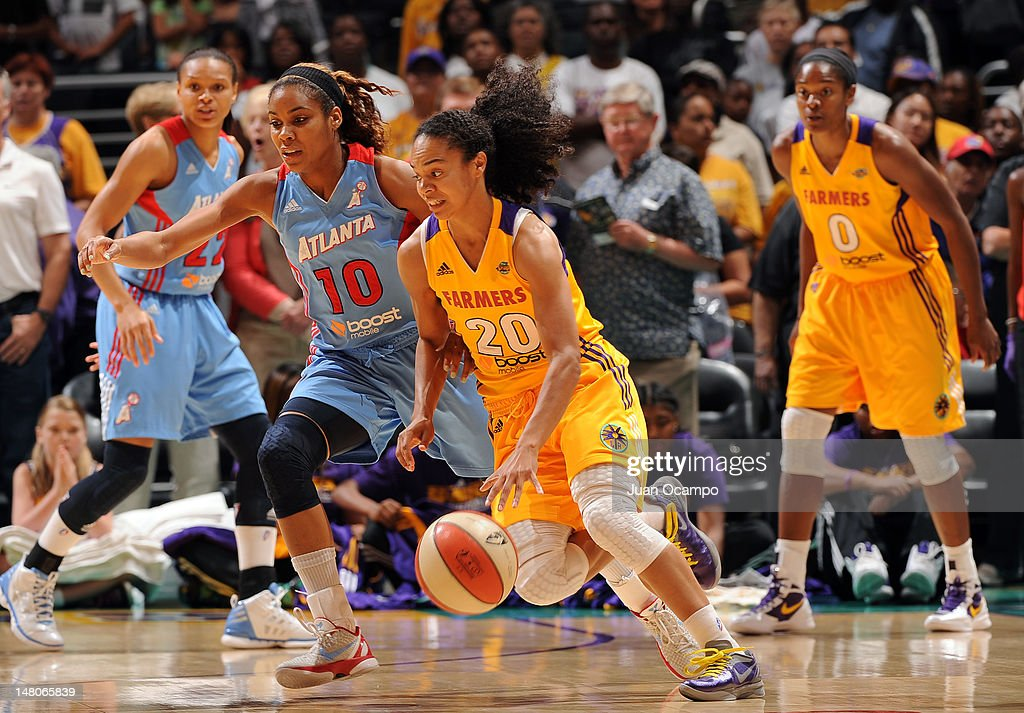 Kristi Toliver of the Los Angeles Sparks handles the ball against Lindsey Harding of the Atlanta Dream at Staples Center on July 8 2012 in Los...