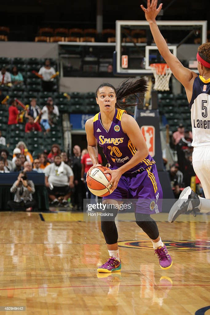 Kristi Toliver #20 of the Los Angeles Sparks handles the ball against the Indiana Fever on July 15, 2014 at Bankers Life Fieldhouse in Indianapolis, Indiana.