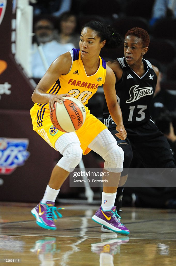 Kristi Toliver #20 of the Los Angeles Sparks handles the ball during a game against Danielle Robinson #13 of the San Antonio Stars in Game 1 of the WNBA Western Conference Semi Finals at Galen Center on September 27, 2012 in Los Angeles, California.