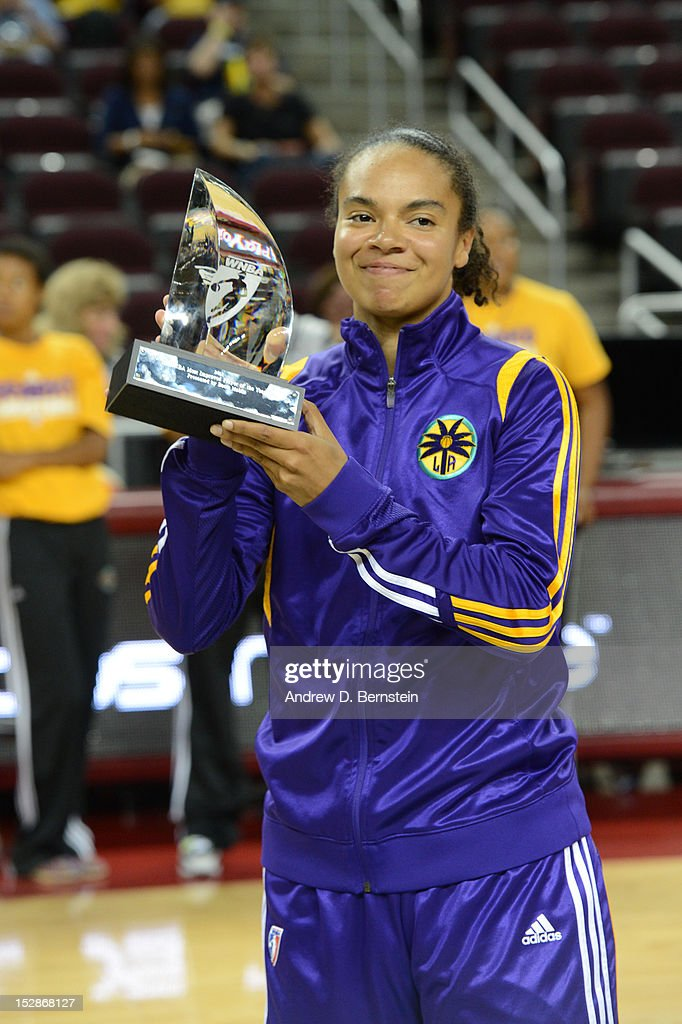 Kristi Toliver #20 of the Los Angeles Sparks holds up her WNA Most Improved Player award prior to a game against the San Antonio Stars in Game 1 of the WNBA Western Conference Semi Finals at Galen Center on September 27, 2012 in Los Angeles, California.