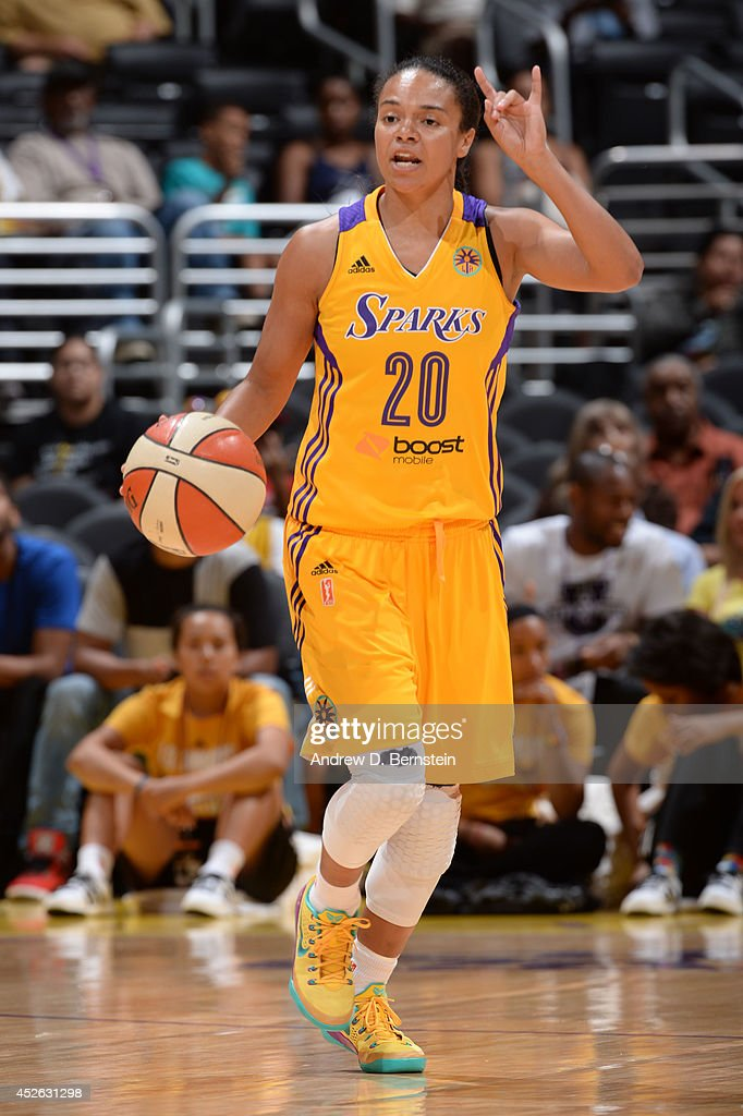 Kristi Toliver #20 of the Los Angeles Sparks moves the ball up-court during a game against the Phoenix Mercury at STAPLES Center on July 24, 2014 in Los Angeles, California.