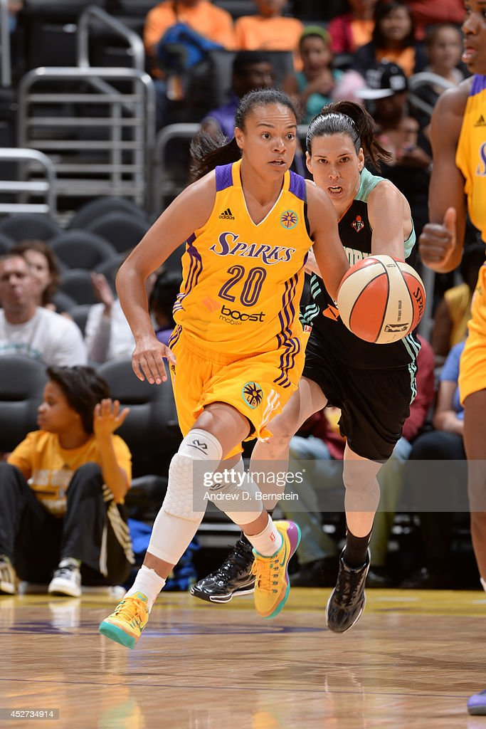 Kristi Toliver #20 of the Los Angeles Sparks moves the ball up-court against the New York Liberty at STAPLES Center on July 23, 2014 in Los Angeles, California.