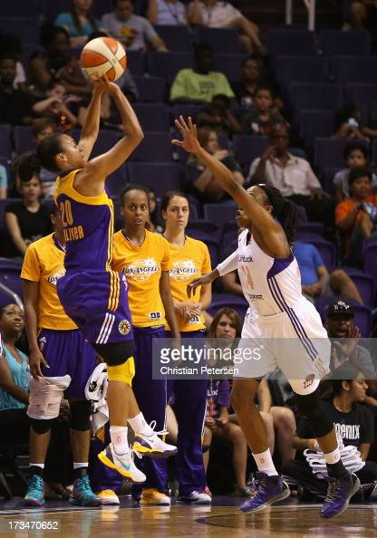 Kristi Toliver of the Los Angeles Sparks puts up a shot over Alexis Hornbuckle of the Phoenix Mercury during the WNBA game at US Airways Center on...