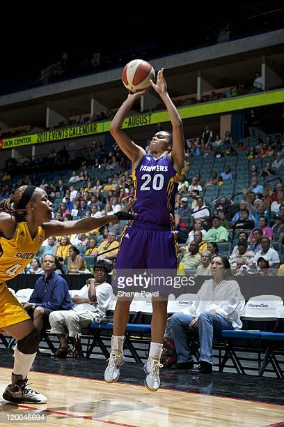 Kristi Toliver of the Los Angeles Sparks shoots the ball against Amber Holt of the Tulsa Shock during the WNBA game on July 15 2011 at the BOK Center...