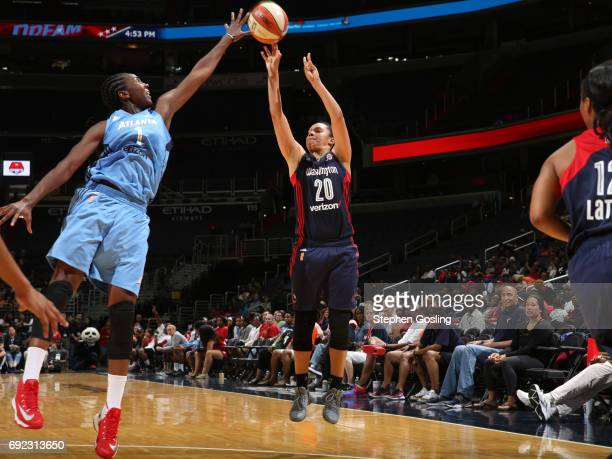 Kristi Toliver of the Washington Mystics shoots the ball against Elizabeth Williams of the Atlanta Dream on June 4 2017 at Verizon Center in...