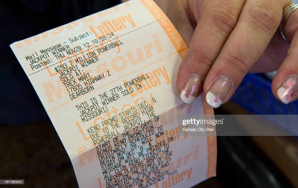 Kristi Williams, a sales associate at the Trex Mart in Dearborn, Missouri, holds a paper Powerball receipt, Thursday, November 29, 2012, stating one of the national winners purchased one of the winning lottery tickets inside the gas station. The location of the winning tickets was announced on Thursday.