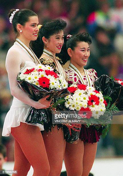 Kristi Yamaguchi from the United States her compatriot Nancy Kerrigan and Japanese Midori Ito smile as they pose on the podium after the medals'...