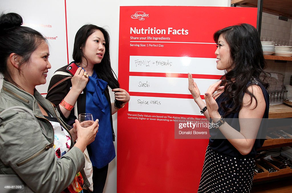 <a gi-track='captionPersonalityLinkClicked' href=/galleries/search?phrase=Kristi+Yamaguchi&family=editorial&specificpeople=234361 ng-click='$event.stopPropagation()'>Kristi Yamaguchi</a> (R) interacts with guests at the Alpine Lace Deli Cheese event on May 6, 2014 in New York City.
