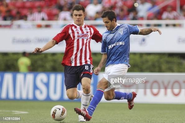 Kristian Alvarez of Chivas and Juan Martinez of Velez during a match ...