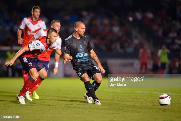 Kristian Alvarez of Veracruz and Emanuel Villa of Queretaro fight for the ball during the fifth round match between Veracruz and Queretaro as part of...