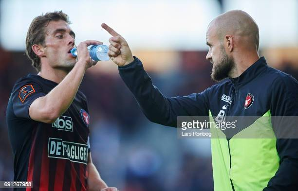 Kristian Bach Bak assistant coach of FC Midtjylland speaks to Jakob Poulsen of FC Midtjylland during the Danish Alka Superliga Europa League Playoff...