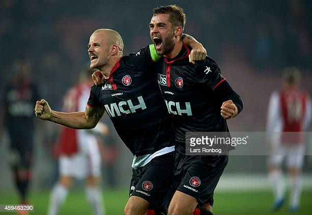 Kristian Bach Bak of FC Midtjylland and team mate Jim Larsen celebrate their victory after the Danish Superliga match between FC Midtjylland and AaB...
