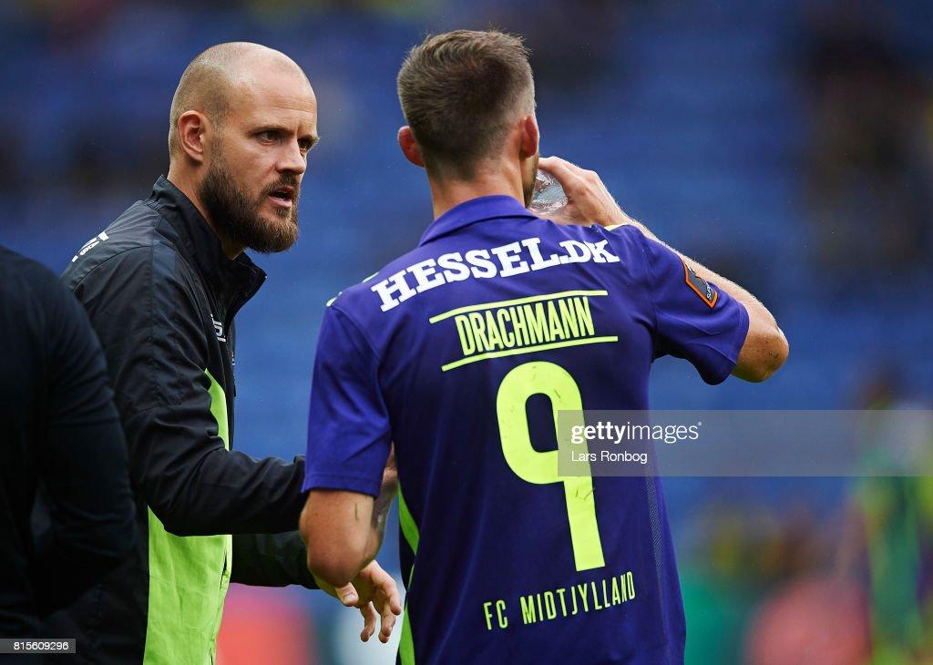 Kristian Back Bak, assistant coach of FC Midtjylland speaks to Janus Drachmann of FC Midtjylland during the Danish Alka Superliga match between Brondby IF and FC Midtjylland at Brondby Stadion on July 16, 2017 in Brondby, Denmark.