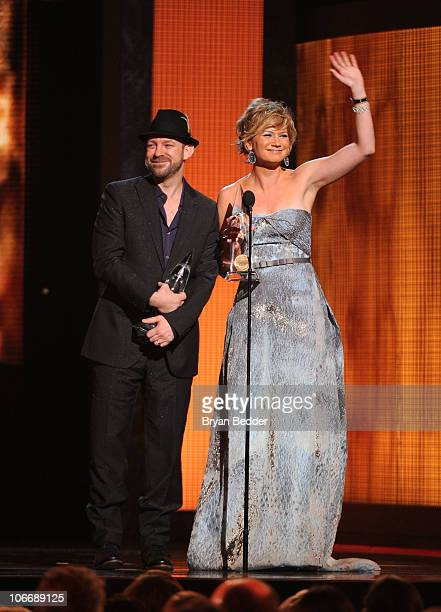 Kristian Bush and Jennifer Nettles of Sugarland accept an award onstage at the 44th Annual CMA Awards at the Bridgestone Arena on November 10 2010 in...