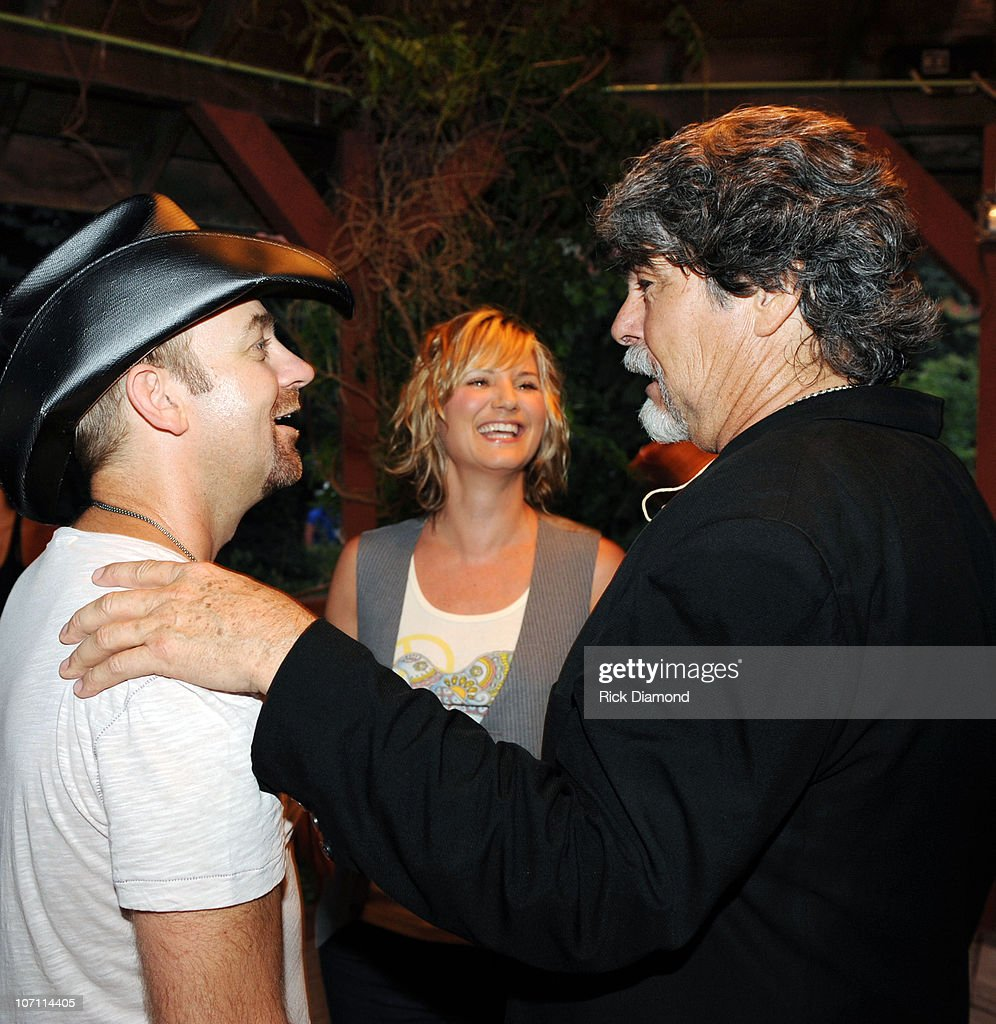 Kristian Bush and Jennifer Nettles of The Group Sugarland stand in Randy Owen's ( formally of the group Alabama) Meet & Greet line and surprise him during the 16th annual Country Thunder festival on July 18, 2008 on Shadow Hill Farm in Twin Lakes, Wisconsin.