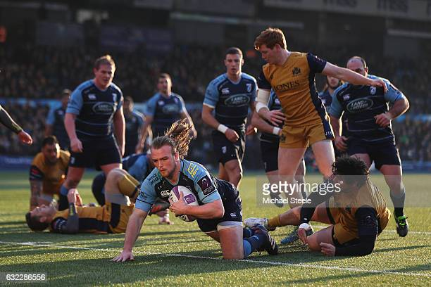 Kristian Dacey of Cardiff scores his sides opening try despite the challenge from Gaston Cortes of Bristol during the European Rugby Challenge Cup...