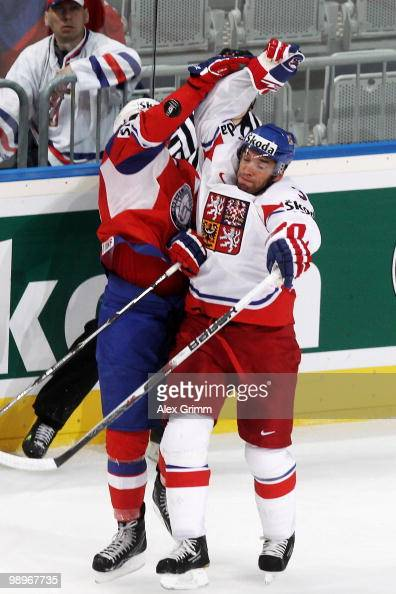 Kristian Forsberg of Norway and Michal Rozsival of Czech Republic try to catch the puck during the IIHF World Championship group C match between...
