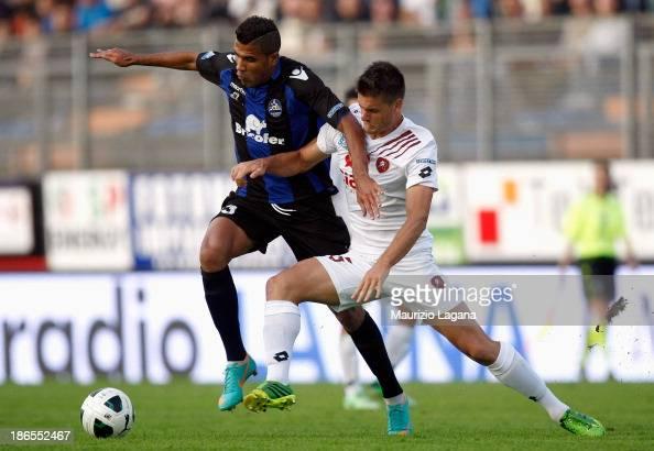 Kristian Ipsa of Reggina competes for the ball with Jonathas of Latina during the Serie B match between US Latina and Reggina Calcio at Stadio...