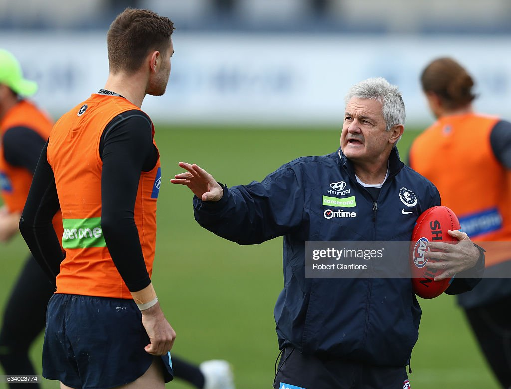 Kristian Jaksch of the Blues speaks with assistant coach Neil Craig during a Carlton Blues AFL training session at Ikon Park on May 25, 2016 in Melbourne, Australia.
