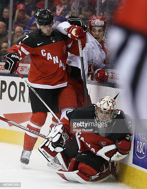 TORONTO ON JANUARY 2 Kristian Jensen sends Zachary Fucale to the ice whicle being checked by Josh Morrissey as Team Canada plays Team Denmark in the...