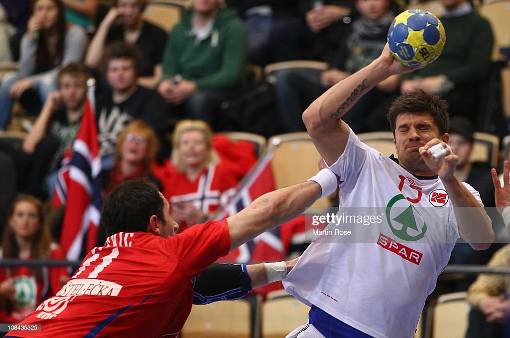 Kristian Kjelling (R) of Norway is challenged by Alem Toskic (L) of Serbia during the Men's Handball World Championship placement match between Norway and Serbia at Kristianstad Arena on January 27, 2011 in Kristianstad, Sweden.