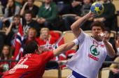 Kristian Kjelling of Norway is challenged by Alem Toskic of Serbia during the Men's Handball World Championship placement match between Norway and...