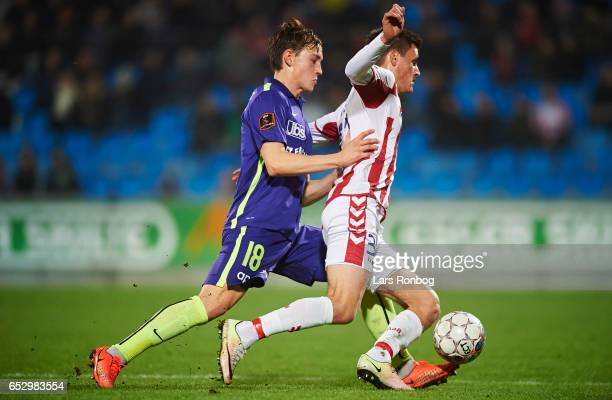 Kristian Riis of FC Midtjylland and Joakim Mahle of AaB Aalborg compete for the ball during the Danish Alka Superliga match between AaB Aalborg and...
