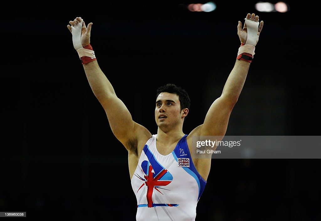 Kristian Thomas of Great Britain celebrates finishing first on the vault during the Gymnastics Trampoline Olympic Qualification round at North Greenwich Arena on January 13, 2012 in London, England.