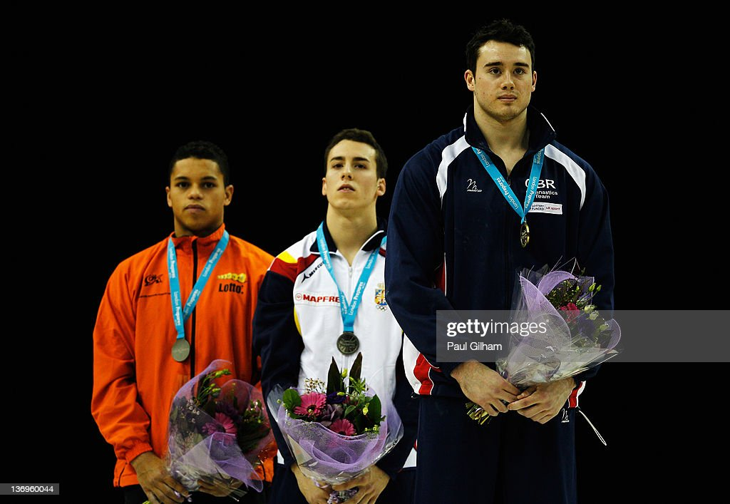 Kristian Thomas of Great Britain looks on during the national anthem after finishing first on the vault during the Gymnastics Trampoline Olympic Qualification round at North Greenwich Arena on January 13, 2012 in London, England.