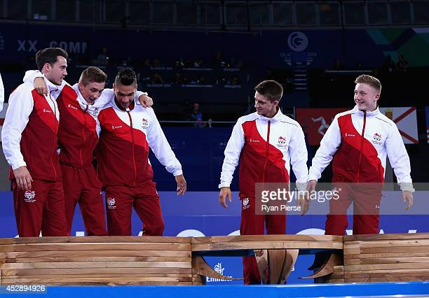 Kristian Thomas Sam Oldham Louis Smith Max Whitlock and Nile Wilson of England celebrate on the podium after wining gold in the Men's Team Event at...