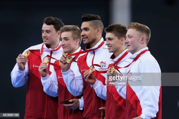 Kristian Thomas Sam Oldham Louis Smith Max Whitlock and Nile Wilson of England receive their gold medals in the Gymnastics Artistic Team Final at...