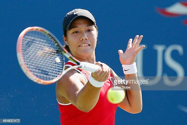 Kristie Ahn of the United States returns a shot against Hayley Carter of the United States during their women's Collegiate Invitational quarterfinal...