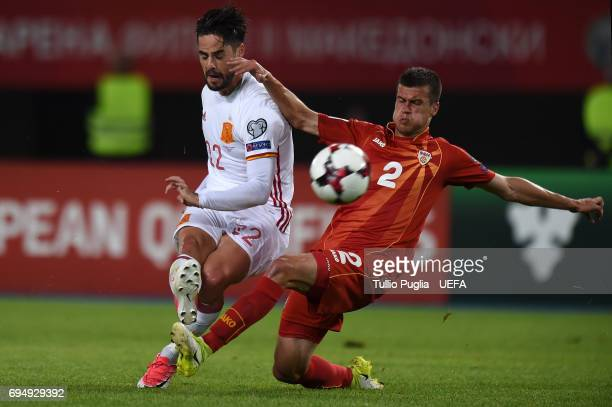 Kristijan Tosevski of FYR Macedonia and Isco of Spain compete for the ball during the FIFA 2018 World Cup Qualifier between FYR Macedonia and Spain...