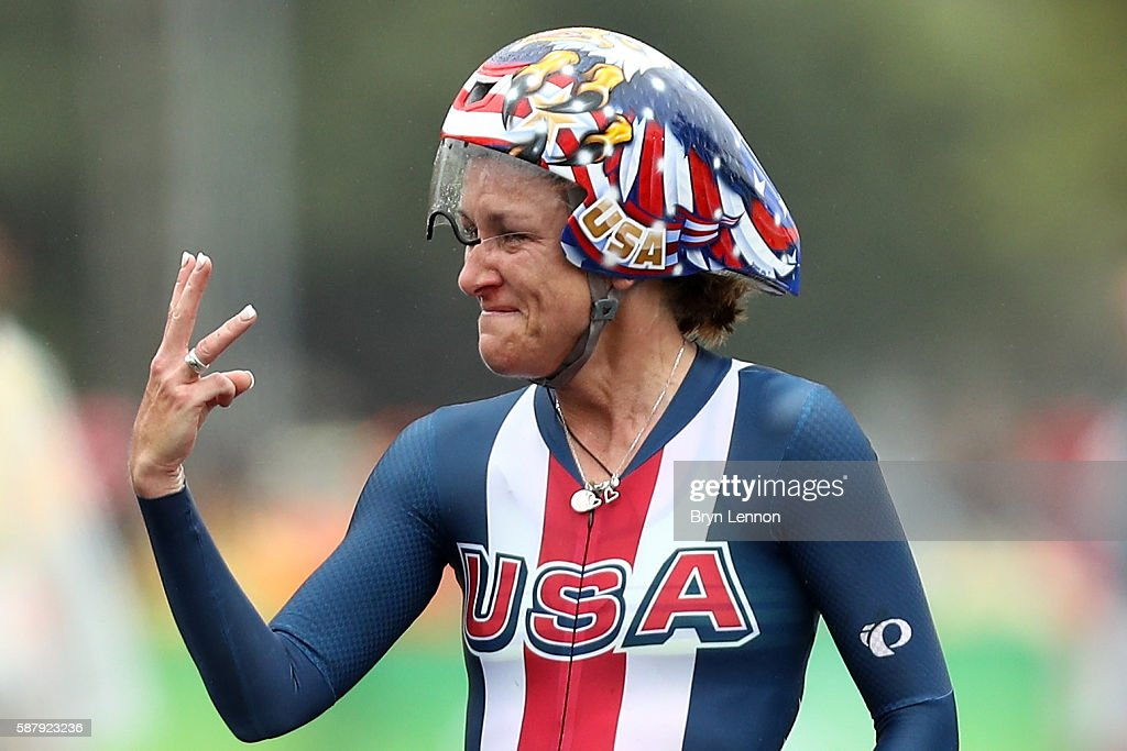 Kristin Armstrong of the United States holds up three fingers after winning her third consecutive gold medal in the Women's Individual Time Trial on...