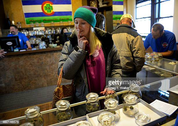 Kristin Brinckerhoff ponders the selection of marijuana at 3D Cannabis Center in Denver CO January 02 2014 Kristin said she waited a day to buy...